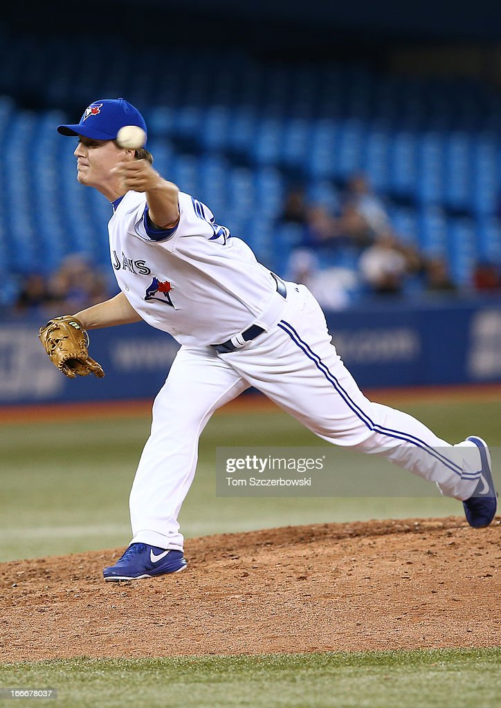 Aaron Loup of the Toronto Blue Jays delivers a pitch during MLB game action against the Chicago White Sox on April 15, 2013 at Rogers Centre in Toronto, Ontario, Canada. All uniformed team members are wearing jersey number 42 in honor of Jackie Robinson Day.