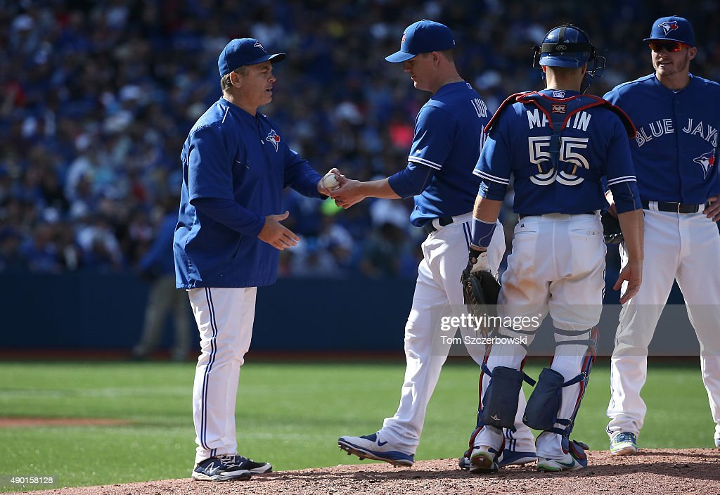 Aaron Loup #62 of the Toronto Blue Jays is relieved by manager John Gibbons #5 after retiring the only batter he faced in the seventh inning during MLB game action against the Tampa Bay Rays on September 26, 2015 at Rogers Centre in Toronto, Ontario, Canada.