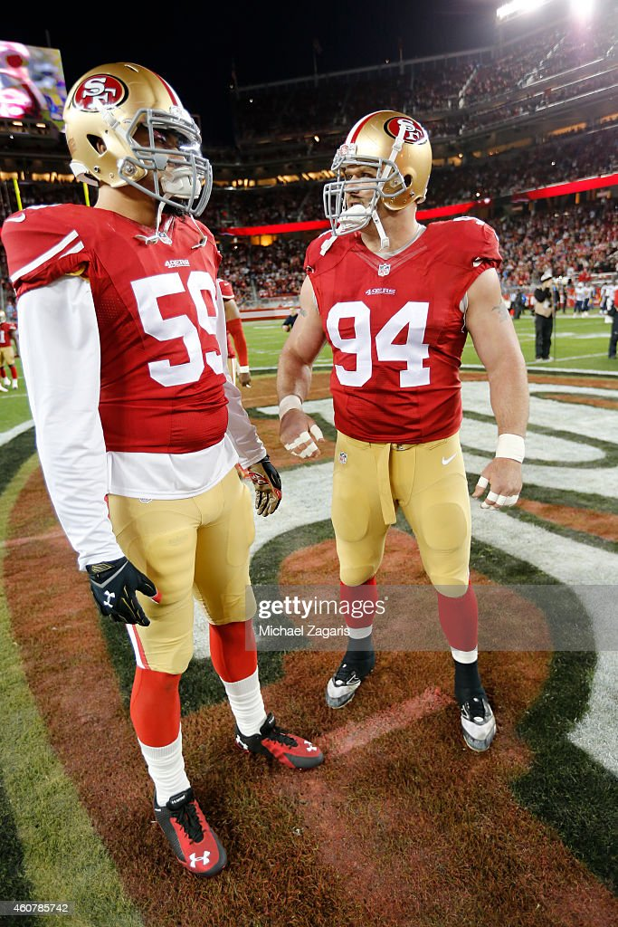 Aaron Lynch #59 and Justin Smith #94 of the San Francisco 49ers stand on the field prior to the game against the San Diego Chargers at Levi Stadium on December 20, 2014 in Santa Clara, California. The Chargers defeated the 49ers 38-35 in overtime.