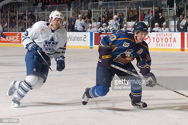 Aaron MacKenzie of the Peoria Rivermen skates against Bates Battaglia of the Toronto Marlies at Ricoh Coliseum on February 3 2006 in Toronto Ontario...