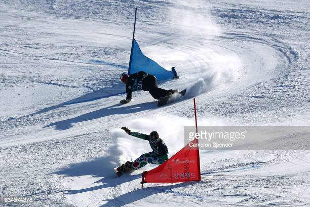 Aaron March of Italy leads Aaron Muss of USA in the FIS Freestyle World Cup Parallel Giant Slalom Mens Final at Bokwang Snow Park on February 12 2017...