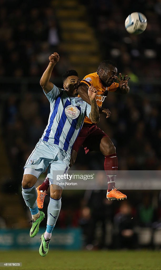 Aaron McLean of Bradford City contests the ball with Jordan Willis of Coventry City during the Sky Bet League One match between Coventry City and Bradford City at Sixfields Stadium on April 1, 2014 in Northampton, England.