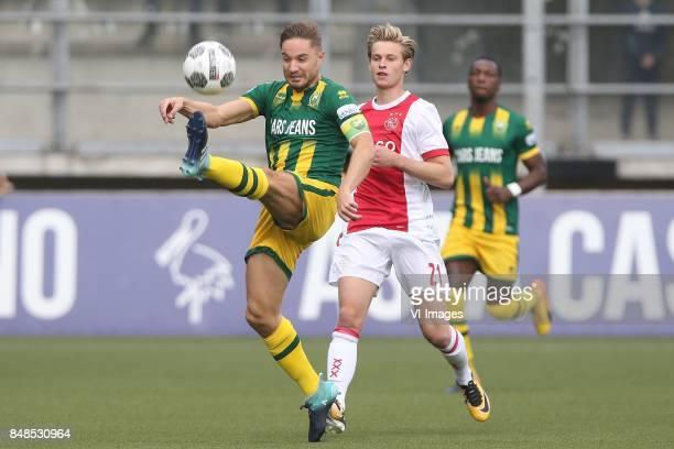 Aaron Meijers of ADO Den Haag Frenkie de Jong of Ajax during the Dutch Eredivisie match between ADO Den Haag and Ajax Amsterdam at Car Jeans stadium...