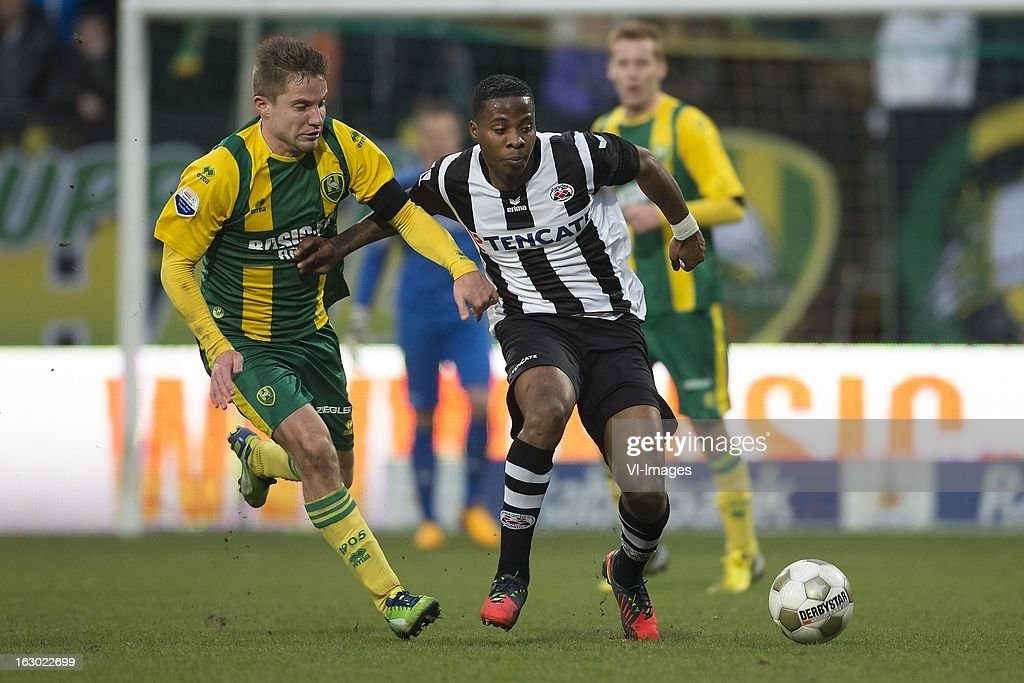 Aaron Meijers of ADO Den Haag, Milano Koenders of Heracles Almelo during the Dutch Eredivisie match between ADO Den Haag and Heracles Almelo at the Kyocera Stadium on march 03, 2013 in The Hague, The Netherlands
