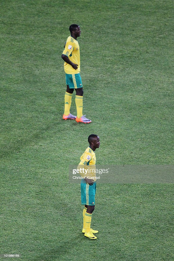 Aaron Mokoena and Siboniso Gaxa of South Africa look dejected during the 2010 FIFA World Cup South Africa Group A match between South Africa and...