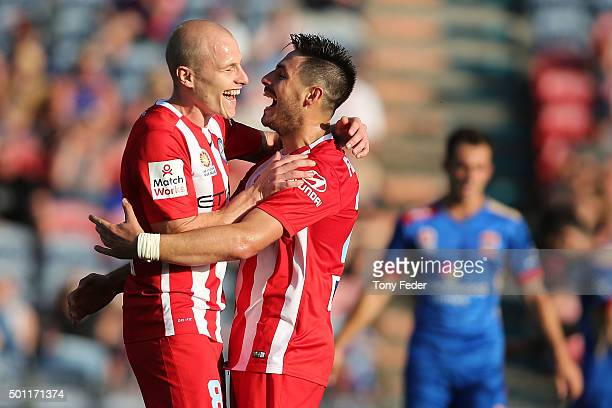 Aaron Mooy and Bruno Fornaroli of Melbourne City celebrate a goal during the ALeague match between the Newcastle Jets and Melbourne City FC at Hunter...