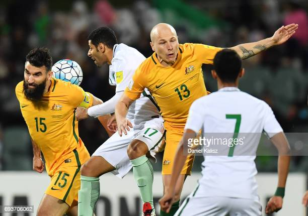 Aaron Mooy and Mile Jedinak of Australia compete for the ball during the 2018 FIFA World Cup Qualifier match between the Australian Socceroos and...