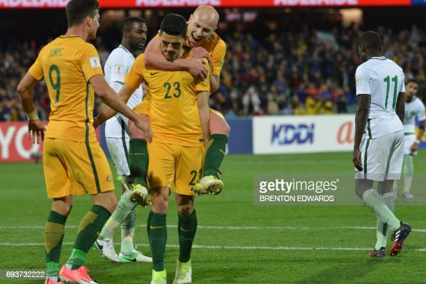 Aaron Mooy congratulates Tomas Rogic after scoring a goal for Australia during the World Cup football Asian qualifying match between Australia and...