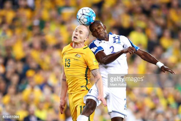 Aaron Mooy of Australia and Brayan Beckeles of Honduras compete for the ball in the air during the 2018 FIFA World Cup Qualifiers Leg 2 match between...