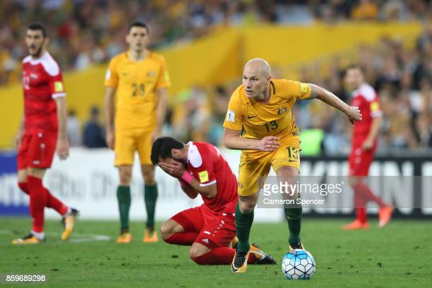 Aaron Mooy of Australia dribbles the ball during the 2018 FIFA World Cup Asian Playoff match between the Australian Socceroos and Syria at ANZ...