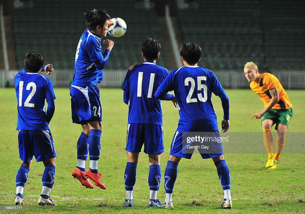 Aaron Mooy (R) of Australia takes a freekick during the EAFF East Asian Cup 2013 Qualifying match between Chinese Tapei and the Australian Socceroos at Hong Kong Stadium on December 9, 2012 in So Kon Po, Hong Kong.