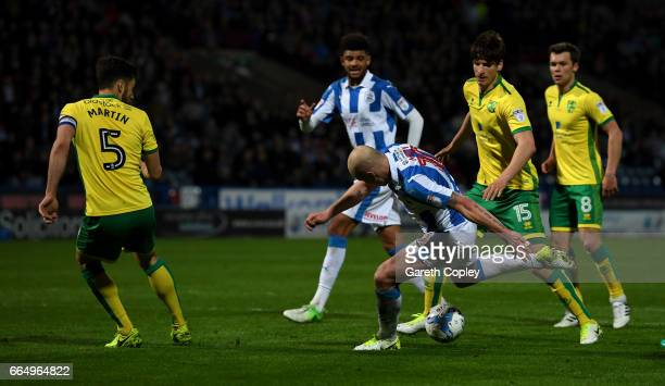 Aaron Mooy of Huddersfield scores his teams second goal during the Sky Bet Championship match between Huddersfield Town and Norwich City at Galpharm...
