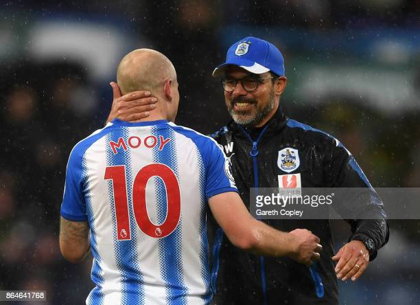 Aaron Mooy of Huddersfield Town and David Wagner Manager of Huddersfield Town celebrate victory after the Premier League match between Huddersfield...