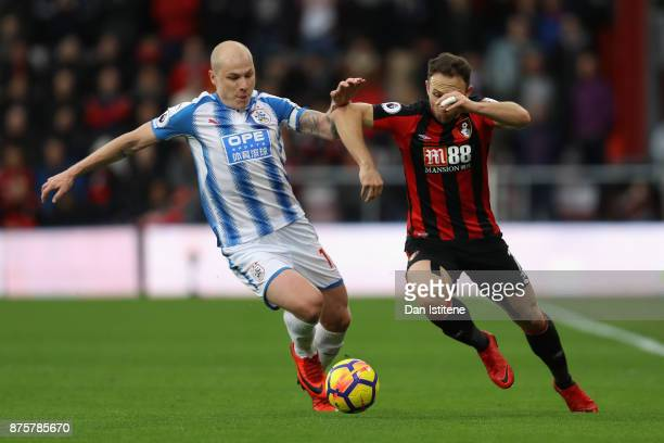 Aaron Mooy of Huddersfield Town and Marc Pugh of AFC Bournemouth compete for the ball during the Premier League match between AFC Bournemouth and...