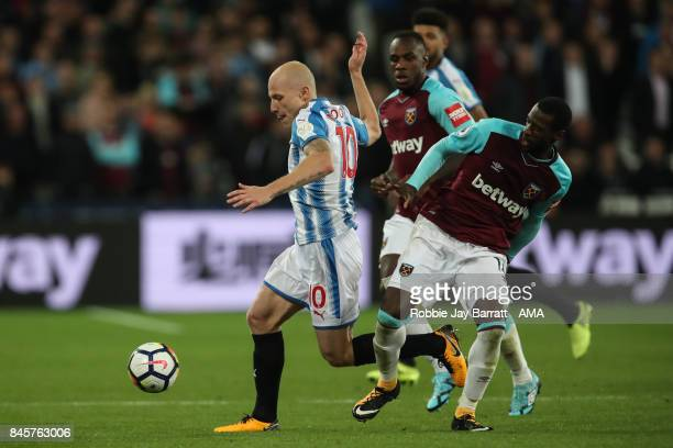 Aaron Mooy of Huddersfield Town and Pedro Mba Obiang of West Ham United during the Premier League match between West Ham United and Huddersfield Town...