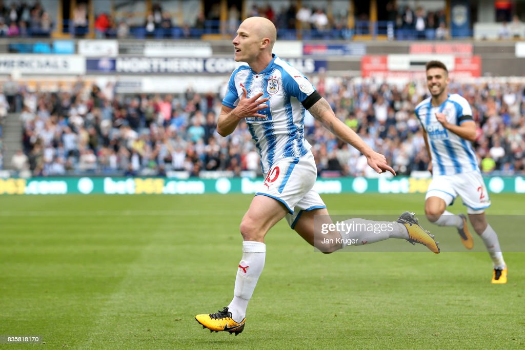 Aaron Mooy of Huddersfield Town celebrates scoring his sides first goal during the Premier League match between Huddersfield Town and Newcastle United at John Smith's Stadium on August 20, 2017 in Huddersfield, England.