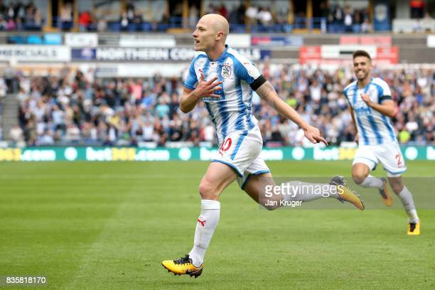 Aaron Mooy of Huddersfield Town celebrates scoring his sides first goal during the Premier League match between Huddersfield Town and Newcastle...