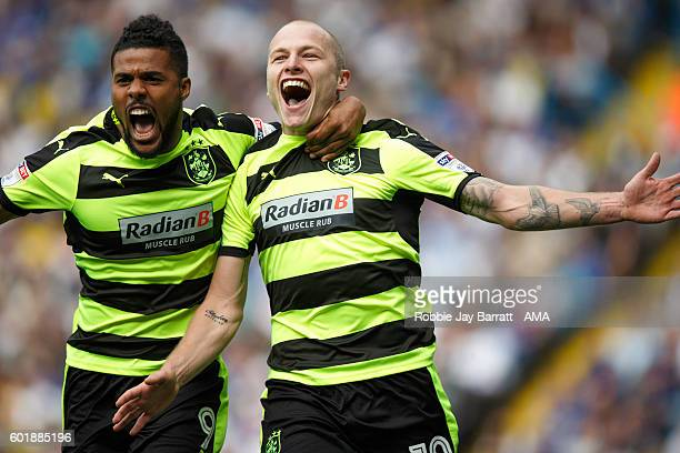 Aaron Mooy of Huddersfield Town celebrates with Elias Kachunga of Huddersfield Town after scoring to make it 01 during the Sky Bet Championship match...