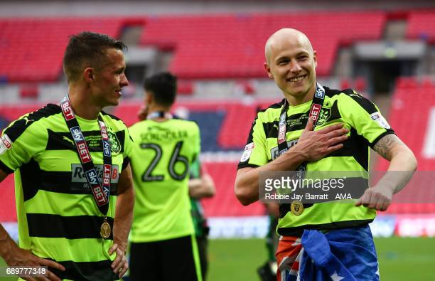 Aaron Mooy of Huddersfield Town celebrates with the fans during the Sky Bet Championship Play Off Final match between Reading and Huddersfield Town...