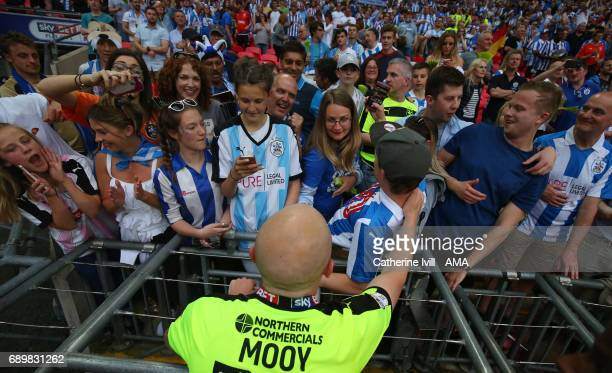 Aaron Mooy of Huddersfield Town has a selfie photo with the fans during the Sky Bet Championship Play Off Final match between Reading and...