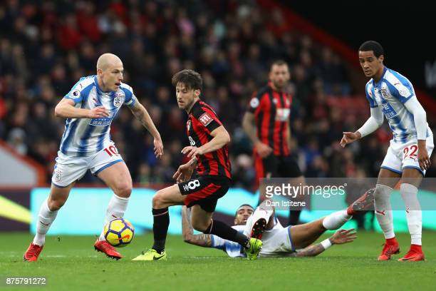 Aaron Mooy of Huddersfield Town moves away from Harry Arter of AFC Bournemouth during the Premier League match between AFC Bournemouth and...