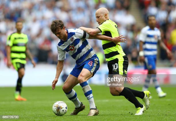 Aaron Mooy of Huddersfield Town puts pressure on John Swift of Reading during the Sky Bet Championship play off final between Huddersfield and...