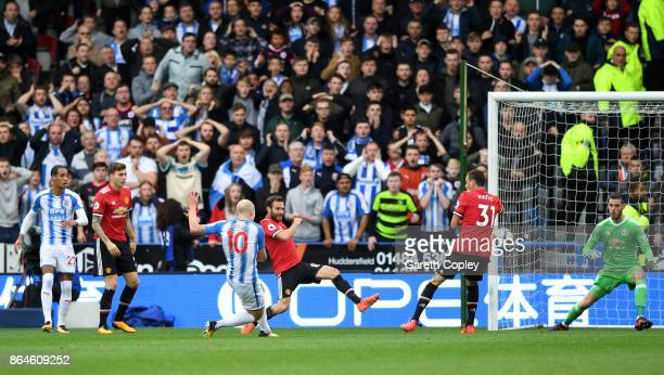 Aaron Mooy of Huddersfield Town scores their first goal during the Premier League match between Huddersfield Town and Manchester United at John...