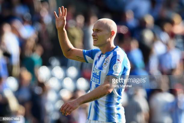 Aaron Mooy of Huddersfield Town shows appreciation to the fans after the Premier League match between Huddersfield Town and Southampton at John...