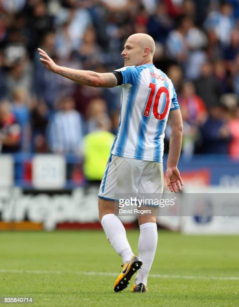 Aaron Mooy of Huddersfield Town who scored the match winning goal celebrates their victory during the Premier League match between Huddersfield Town...