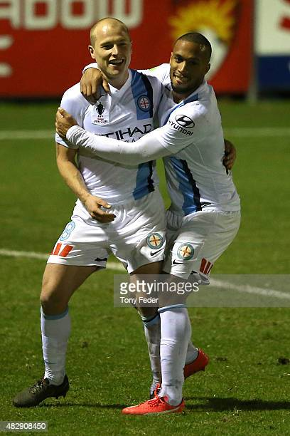 Aaron Mooy of Melbourne City celebrates a goal with a team mate during the FFA Cup match between Edgeworth FC and Melbourne City FC at Magic Park on...