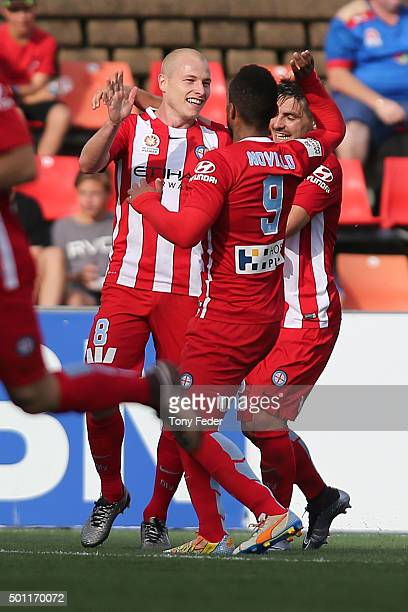 Aaron Mooy of Melbourne City celebrates a goal with team mates during the ALeague match between the Newcastle Jets and Melbourne City FC at Hunter...