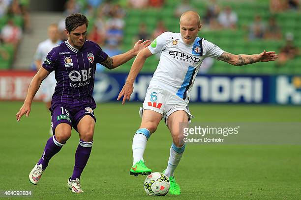 Aaron Mooy of Melbourne City controls the ball under pressure from Joshua Risdon of Perth Glory during the round 18 ALeague match between Melbourne...
