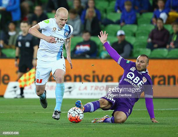 Aaron Mooy of Melbourne City gest away from Nebojsa Marinkovic of Perth Glory during the round eight ALeague match between Melbourne City FC and...