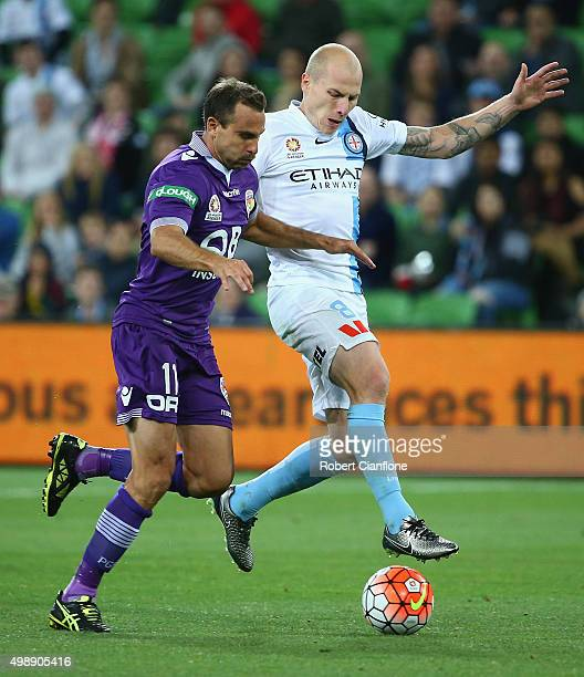 Aaron Mooy of Melbourne City is challenged by Richard Garcia of Perth Glory during the round eight ALeague match between Melbourne City FC and Perth...