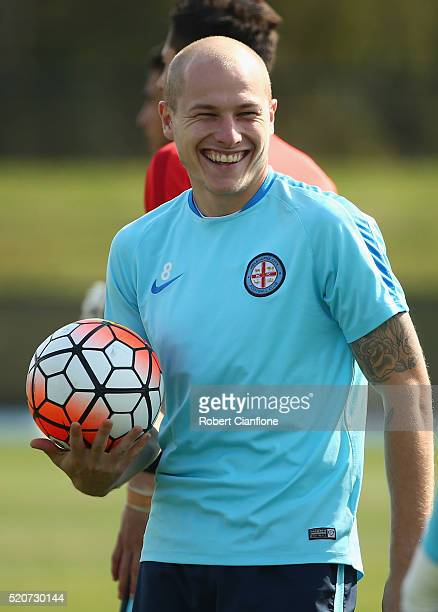 Aaron Mooy of Melbourne City laughs during a Melbourne City ALeague training session at City Football Academy on April 13 2016 in Melbourne Australia