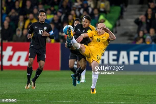 Aaron Mooy of the Australian National Football Team and Chanathip Songkrasin of the Thailand National Football Team contest the ball during the FIFA...
