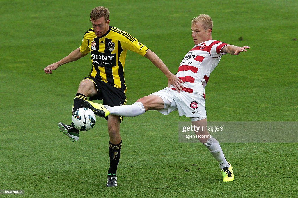Aaron Mooy of the Wanderers and Alexander Smith of the Phoenix challenge for the ball during the round 16 A-League match between the Wellington Phoenix and the Western Sydney Wanderers at Westpac Stadium on January 13, 2013 in Wellington, New Zealand.