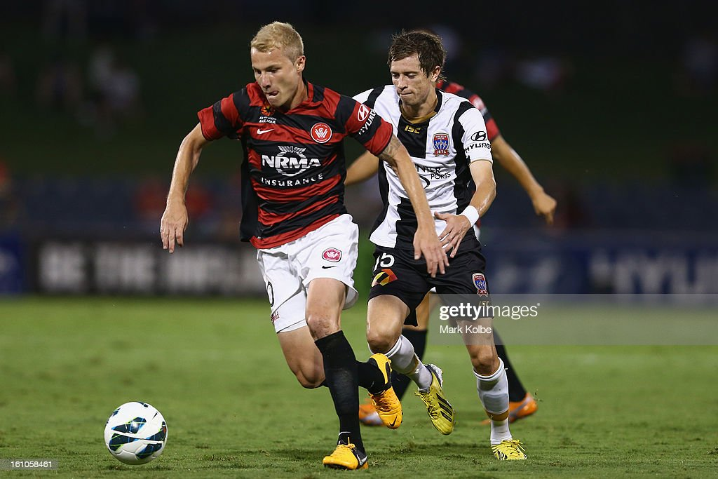 Aaron Mooy of the Wanderers runs the ball during the round 20 A-League match between the Western Sydney Wanderers and the Newcastle Jets at Campbelltown Sports Stadium on February 9, 2013 in Sydney, Australia.