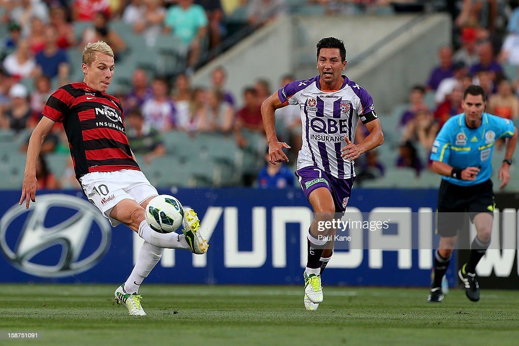 Aaron Mooy of the Wanderers traps the ball against Jacob Burns of the Glory during the round 13 A-League match between the Perth Glory and the Western Sydney Wanderers at Patersons Stadium on December 27, 2012 in Perth, Australia.
