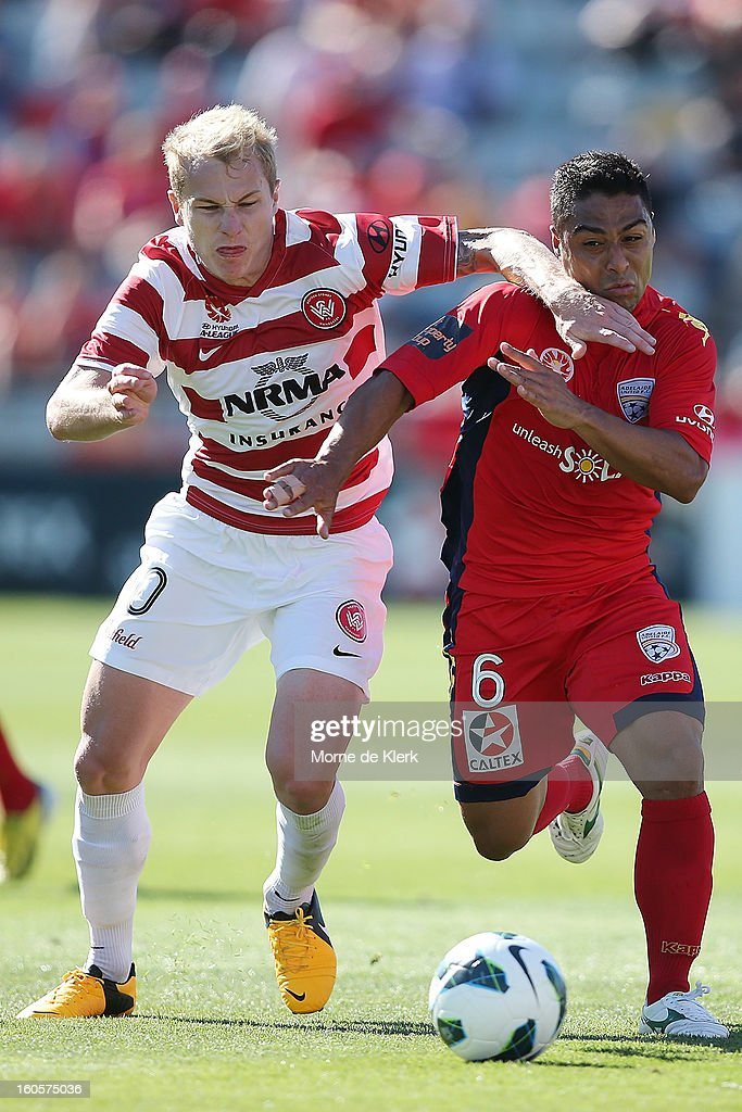 Aaron Mooy of Western Sydney competes with Cassio of Adelaide during the round 19 A-League match between Adelaide United and the Western Sydney Wanderers at Hindmarsh Stadium on February 3, 2013 in Adelaide, Australia.