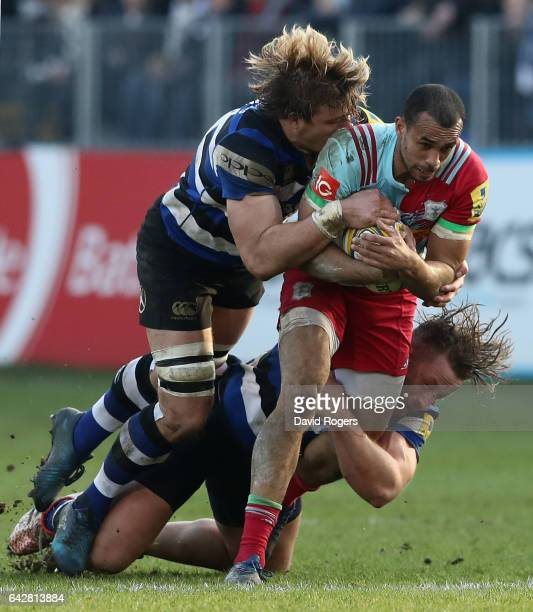 Aaron Morris of Harlequins is tackled by David Denton and Max Lahiff during the Aviva Premiership match between Bath Rugby and Harlequins at the...