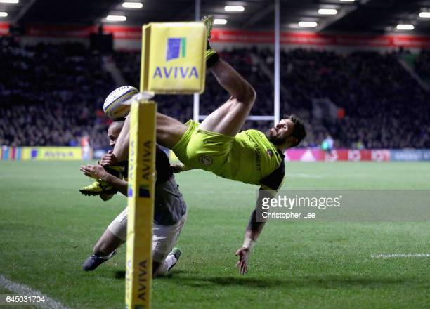 Aaron Morris of Harlequins seems to tackle Adam Thompstone of Leicester Tigers in mid air is Leicester are awarded a penalty try during the Aviva...