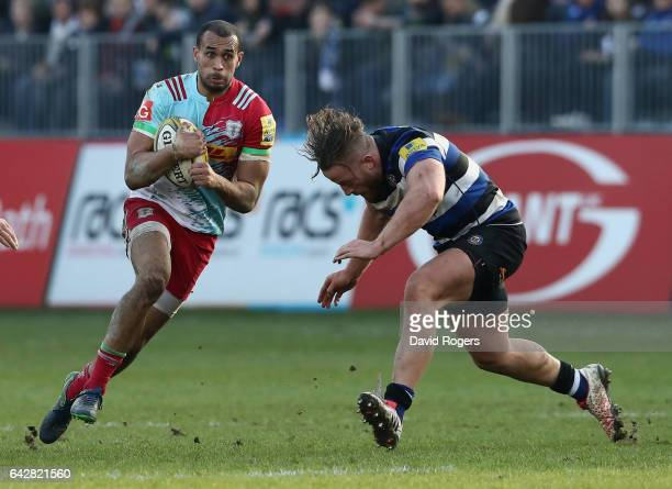 Aaron Morris of Harlequins takes on Max Lahiff during the Aviva Premiership match between Bath Rugby and Harlequins at the Recreation Ground on...