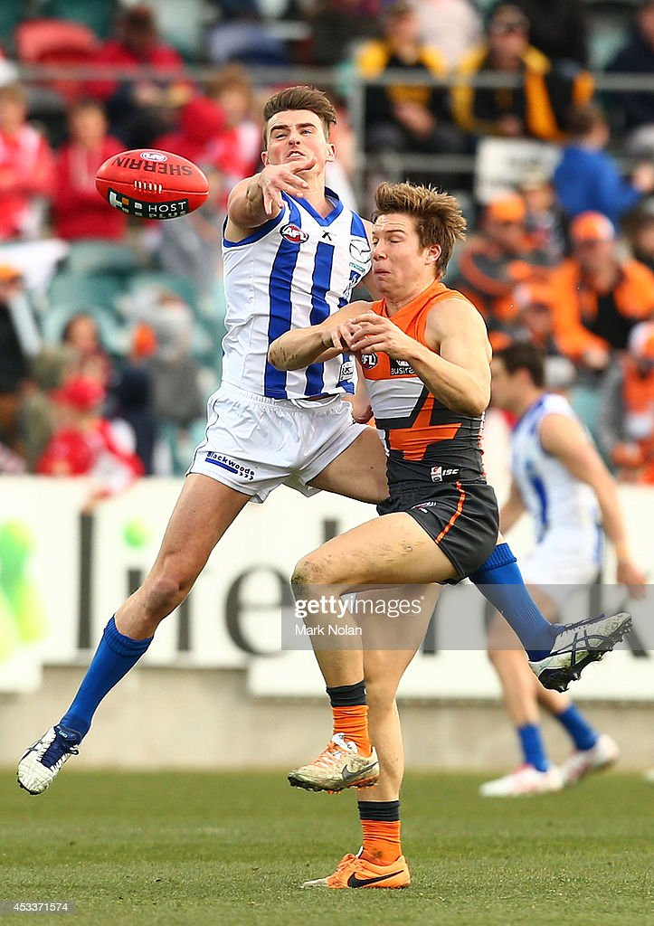 Aaron Mullet of the Kangaroos spoils a mark for Toby Greene of the Giants during the round 20 AFL match between the Greater Western Sydney Giants and the North Melbourne Kangaroos at Stratrack Oval on August 9, 2014 in Canberra, Australia.