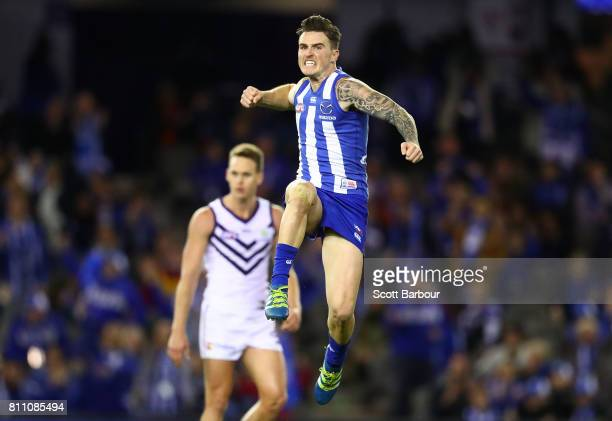 Aaron Mullett of the Kangaroos celebrates after kicking a goal during the round 16 AFL match between the North Melbourne Kangaroos and the Fremantle...