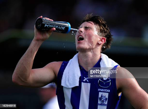 Aaron Mullett of the Kangaroos sprays water on his face during the round two AFL NAB Cup match between the Gold Coast Suns and the North Melbourne...
