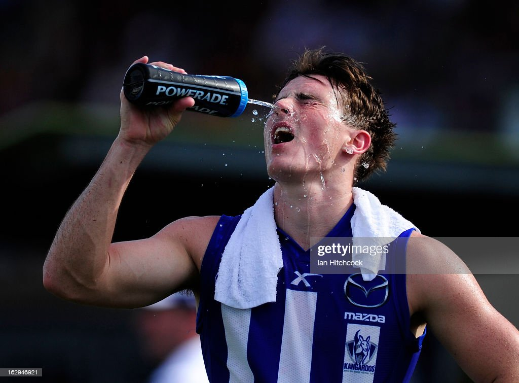 Aaron Mullett of the Kangaroos sprays water on his face during the round two AFL NAB Cup match between the Gold Coast Suns and the North Melbourne Kangaroos at Tony Ireland Stadium on March 2, 2013 in Townsville, Australia.