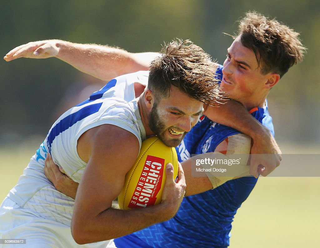 Aaron Mullett tackles Luke McDonald of the Kangaroos during the North Melbourne AFL Intra-Club match at Arden Street Ground on February 12, 2016 in Melbourne, Australia.