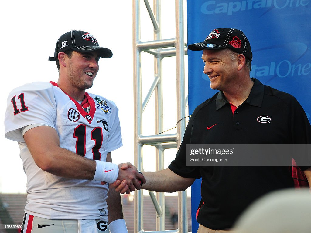 Aaron Murray #11 and Head Coach <a gi-track='captionPersonalityLinkClicked' href=/galleries/search?phrase=Mark+Richt&family=editorial&specificpeople=2080397 ng-click='$event.stopPropagation()'>Mark Richt</a> of the Georgia Bulldogs celebrate after the Capital One Bowl against the Nebraska Cornhuskers at the Citrus Bowl on January 1, 2013 in Orlando, Florida.