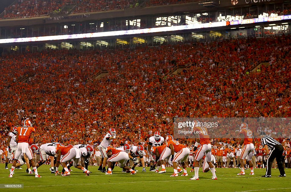 Aaron Murray #11 of the Georgia Bulldogs calls a play against the Clemson Tigers during their game at Memorial Stadium on August 31, 2013 in Clemson, South Carolina.